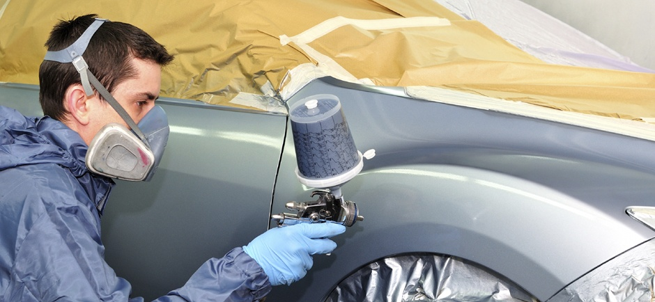 Technician Painting a car